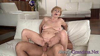 Busty pensioner takes cum