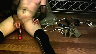 Anal fucking with toy in fishnets until cumming