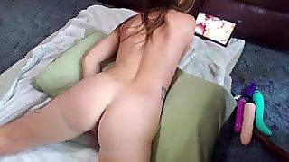 Hot brunette humps hand & sucks vibrator while watching lesbian porn