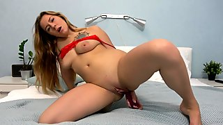 Masturbating with my dildo on the bed